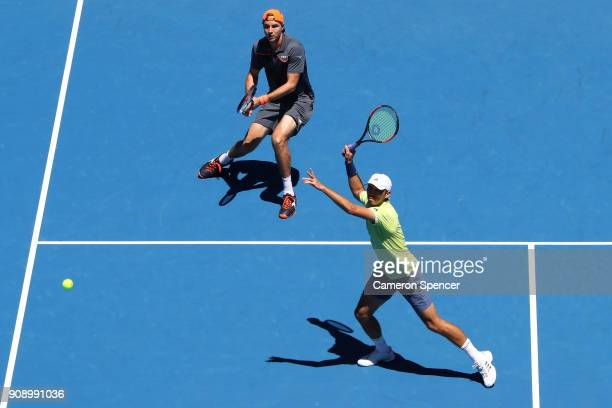 JanLennard Struff of Germany and Ben McLachlan of Japan compete in their fourth round men's doubles match against Lukasz Kubot of Poland and Marcelo...