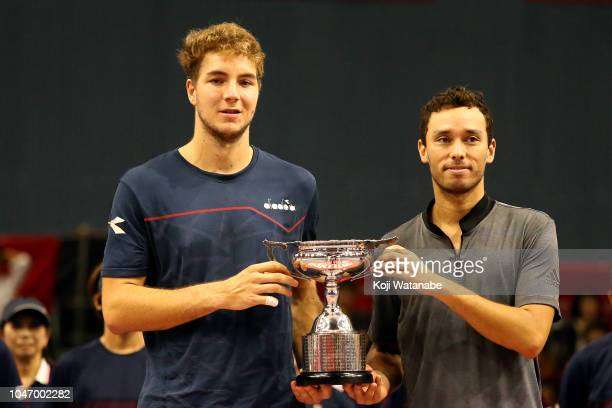 JanLennard Struff of Germany and Ben McLachlan of Japan pose for photographs with the trophy after the Doubles finals round against Raven Klaasen of...