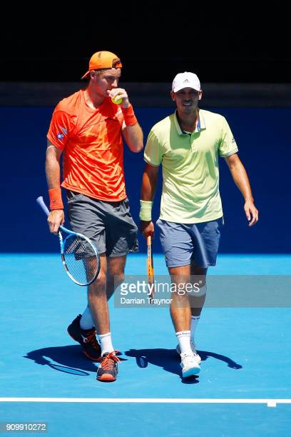 JanLennard Struff of Germany and Ben McLachlan of Japan talk tactics in their men's doubles semifinal match against Oliver Marach of Austria and Mate...
