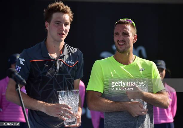 JanLennard Struff of Germany and Viktor Troicki of Serbia poses with their runnersup trophies in their men's doublesfinal against Marcelo Melo of...