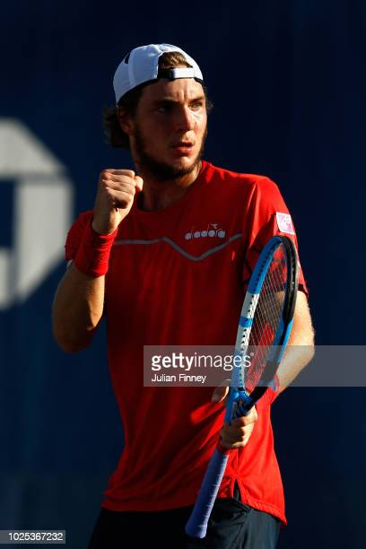 JanLennard Struff of Germany celebrates a point during his men's singles second round match against Julien Benneteau of France on Day Four of the...