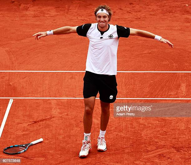 JanLennard Struff of Germany celebrates winning the 5th rubber match between JanLennard Struff of Germany and Hubert Hurkacz of Poland in the Davis...
