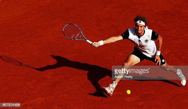JanLennard Struff of Germany hits a forehand on his way to winning the 5th rubber match between JanLennard Struff of Germany and Hubert Hurkacz of...