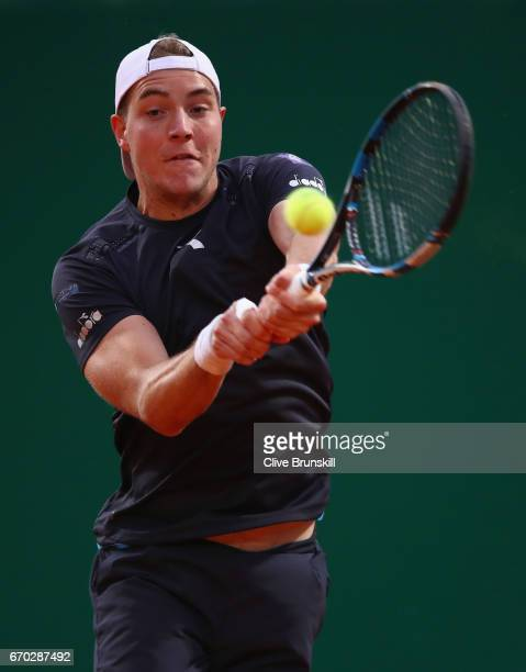 JanLennard Struff of Germany plays a backhand against Grigor Dimitrov of Bulgaria in his second round match on day four of the Monte Carlo Rolex...