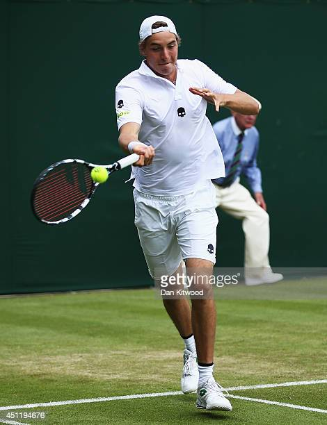 JanLennard Struff of Germany plays a backhand shot during his Gentlemen's Doubles first round match with Dustin Brown against Ken Skupski and Neal...