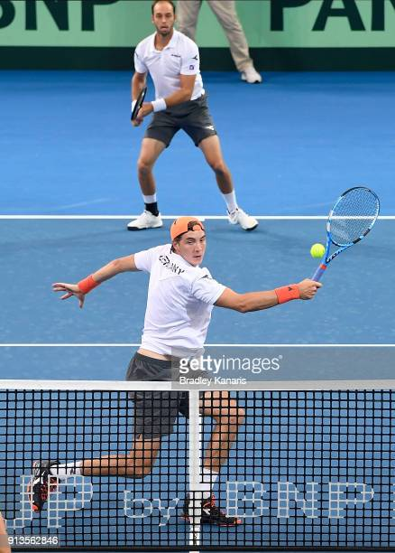 Jan-Lennard Struff of Germany plays a backhand volley in his doubles match with Tim Putz against Matt Ebden and John Peers of Australia during the...