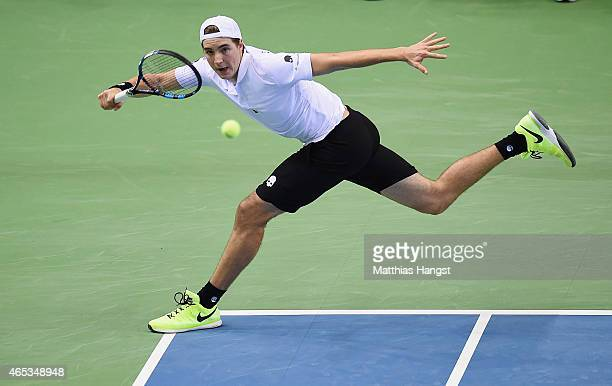 JanLennard Struff of Germany plays a forehand against Gilles Simon of France during day one of the Davis Cup World Group first round between Germany...