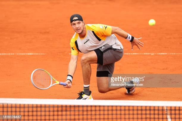 Jan-Lennard Struff of Germany plays a forehand during his 2nd round match against Dominik Koepfer of Germany on day 6 of the BMW Open at MTTC IPHITOS...