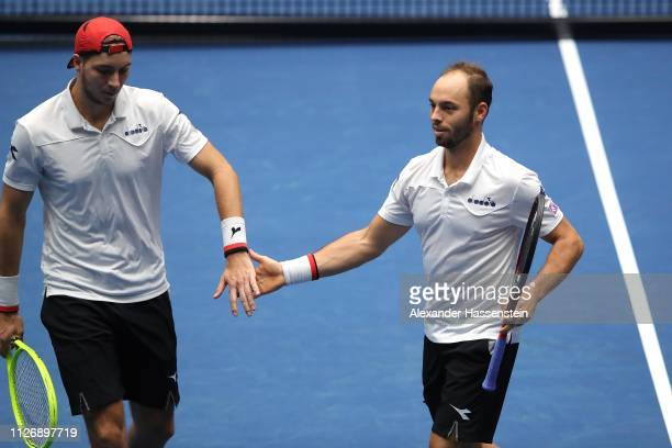 Jan-Lennard Struff of Germany reacts with his team mate Tim Puetz during her double match against Gabor Borsos and Peter Nagy of Hungary on day two...