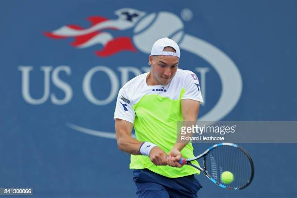 JanLennard Struff of Germany returns a shot against Nick Kyrgios of Australia and Matt Reid of Australia during their first round Men's Doubles match...