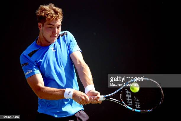 JanLennard Struff of Germany returns a shot to Aljaz Bedene of Great Britain during the Miami Open at the Crandon Park Tennis Center on March 22 2017...