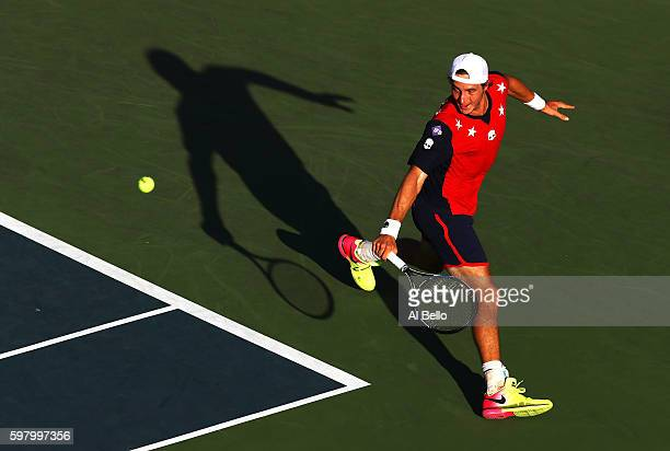 JanLennard Struff of Germany returns a shot to Donald Young of the United States during his first round Men's Singles match on Day Two of the 2016 US...