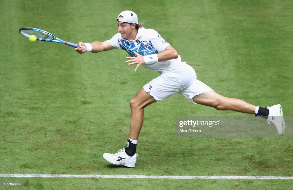 Jan-Lennard Struff of Germany returns the ball to Roberto Bautista Agut of Spain during their first round match on day 1 of the Gerry Weber Open at Gerry Weber Stadium on June 18, 2018 in Halle, Germany.