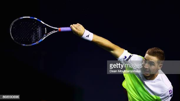 JanLennard Struff of Germany serves against Borna Coric of Croatia during Day 2 of the Rolex Paris Masters held at the AccorHotels Arena on October...