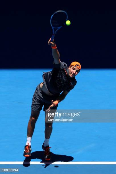 JanLennard Struff of Germany serves in his fourth round men's doubles match with Ben McLachlan of Japan against Lukasz Kubot of Poland and Marcelo...