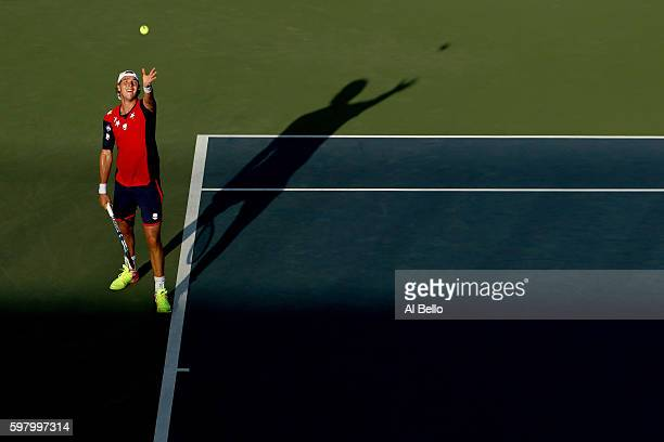 JanLennard Struff of Germany serves to Donald Young of the United States during his first round Men's Singles match on Day Two of the 2016 US Open at...