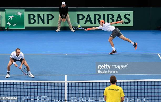 Jan-Lennard Struff of Germany stretches out to play a shot in the doubles match with Tim Putz against Matt Ebden and John Peers of Australia during...