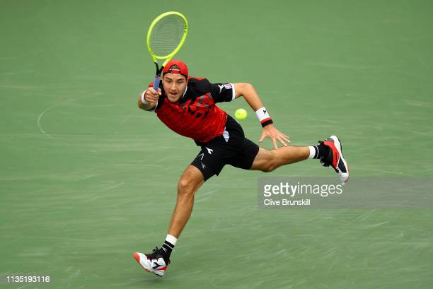 Jan-Lennard Stuff of Germany plays a forehand against Alexander Zverev of Germany during their men's singles third round match on day eight of the...