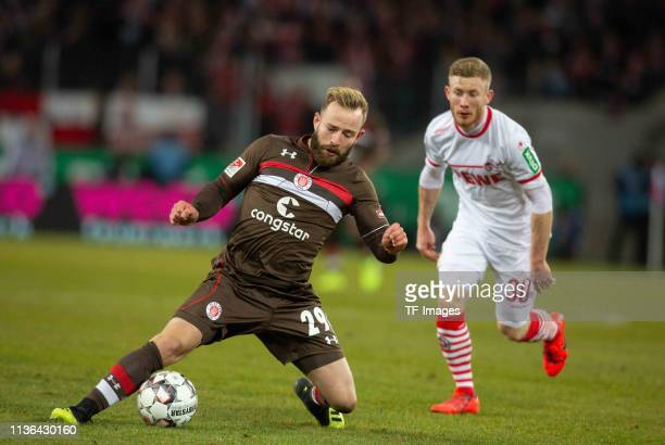 JanMarc Schneider of FC St Pauli and Florian Kainz of 1 FC Koeln battle for the ball during the Second Bundesliga match between 1 FC Koeln and FC St...