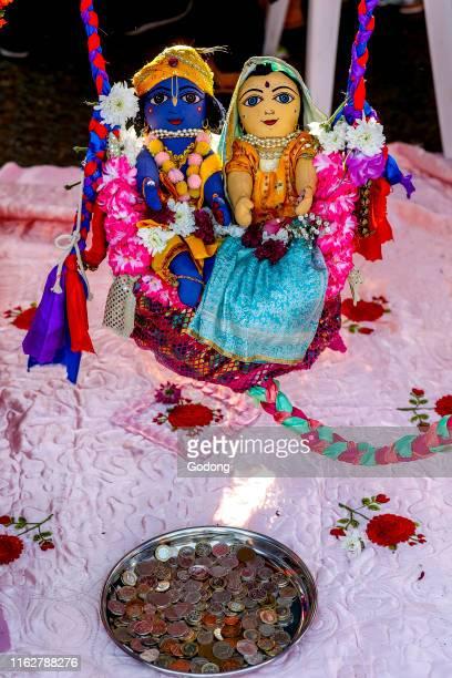 Janmashtami festival at Bhaktivedanta Manor, Watford, U.K. Krishna and Radha on a swing. Visitors pull the swing and give a donation.