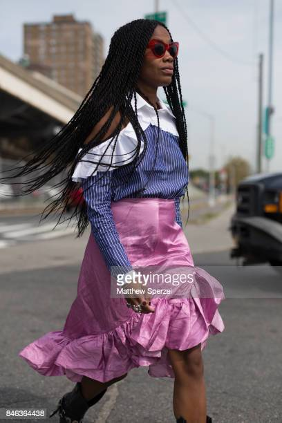 JanMichael Quammie is seen attending Coach during New York Fashion Week wearing a blue and whtie striped top with pink skirt on September 12 2017 in...