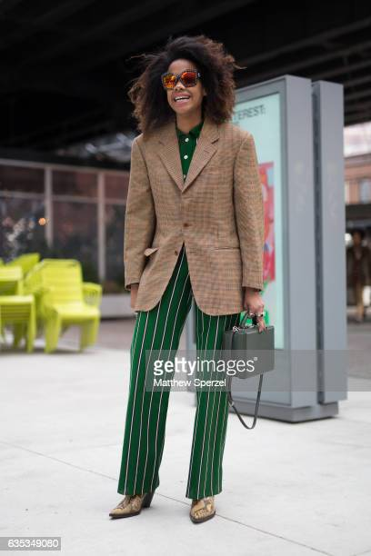JanMichael Quammie is seen attending Tory Burch during New York Fashion Week wearing a brown blazer with green striped pants on February 14 2017 in...