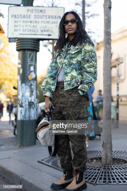 JanMichael Quammie is seen on the street during Paris Fashion Week SS19 wearing vintage design jacket with camo cargo pants on September 27 2018 in...