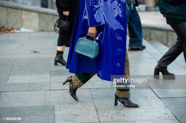 JanMichael Quammie seen wearing blue vinyl coat green turtleneck denim jeans bag during day 3 of the MercedesBenz Tbilisi Fashion Week on November 02...