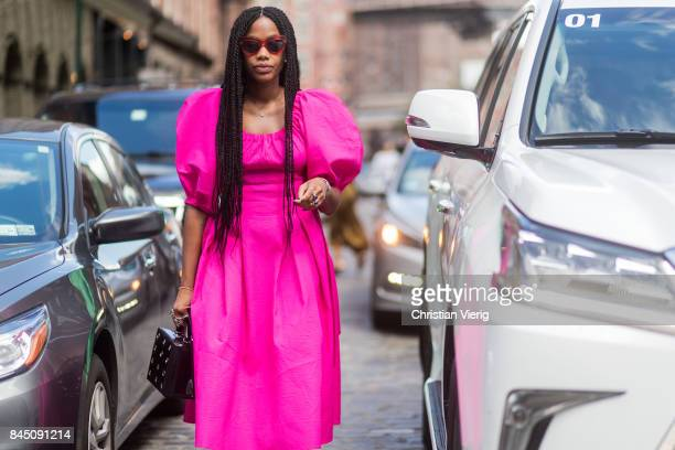 JanMichael Quammie wearing a pink dress seen in the streets of Manhattan outside Tibi during New York Fashion Week on September 9 2017 in New York...
