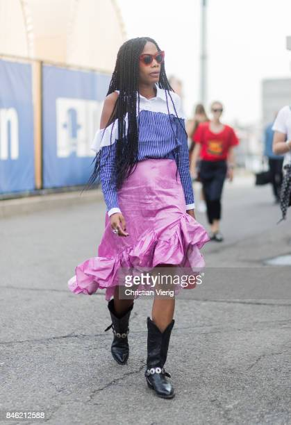 JanMichael Quammie wearing a pink ruffled skirt with slit seen in the streets of Manhattan outside Coach during New York Fashion Week on September 12...