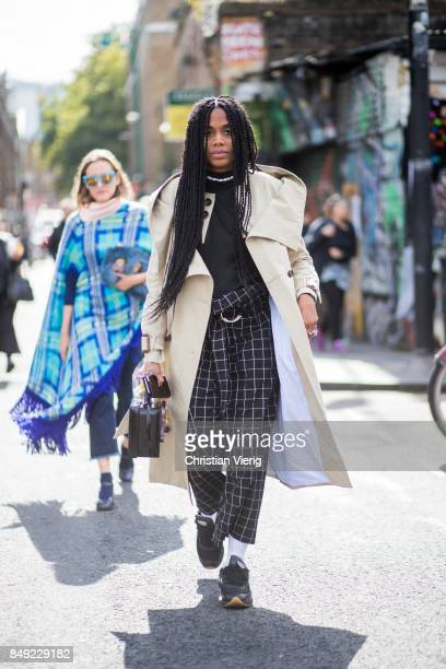 JanMichael Quammie wearing black checked pants trench coat outside Marques Almeida during London Fashion Week September 2017 on September 18 2017 in...