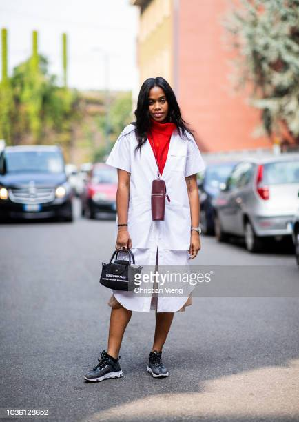 JanMichael Quammie wearing red turtleneck white sleeveless coat is seen outside Jil Sander during Milan Fashion Week Spring/Summer 2019 on September...