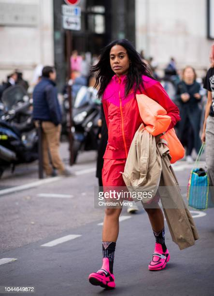 JanMichael Quammie wearing zipped jacket pink sneakers is seen outside Sacai during Paris Fashion Week Womenswear Spring/Summer 2019 on October 1...