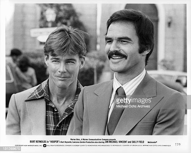 JanMichael Vincent and Burt Reynolds smiling in a scene from the film 'Hooper' 1978