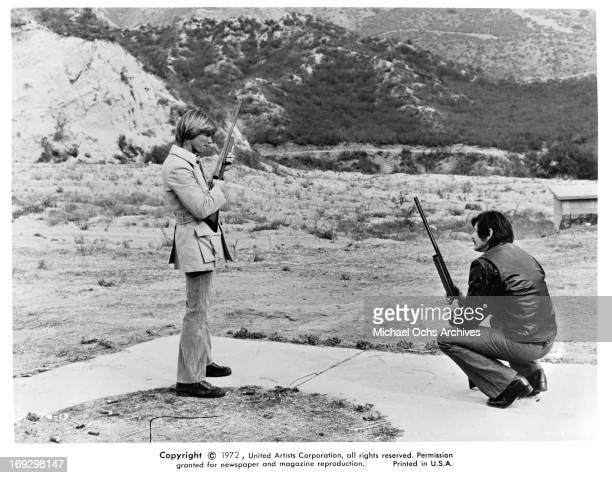 JanMichael Vincent And Charles Bronson with guns in a scene from the film 'The Mechanic' 1972
