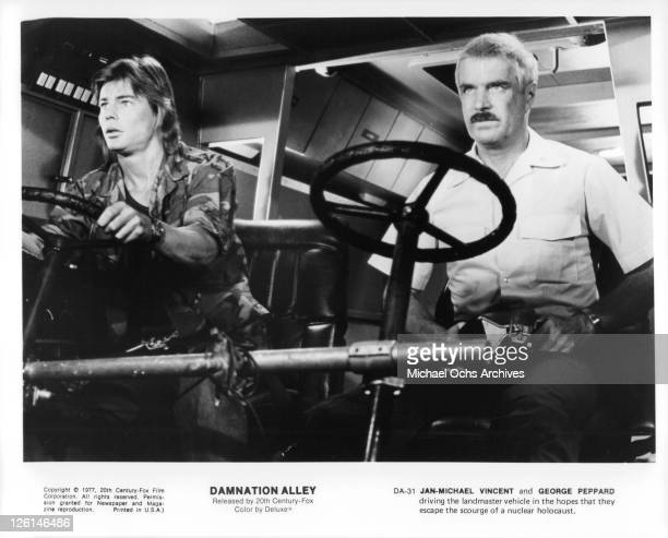 JanMichael Vincent and George Peppard driving the landmaster vehicle in the hopes that they escape the scourge of a nuclear holocaust in a scene from...