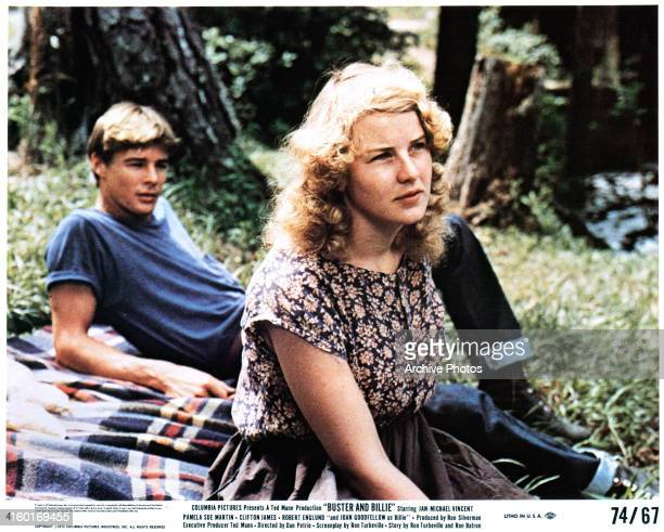 JanMichael Vincent and Joan Goodfellow sit outside in a scene from the film 'Buster And Billie' 1974