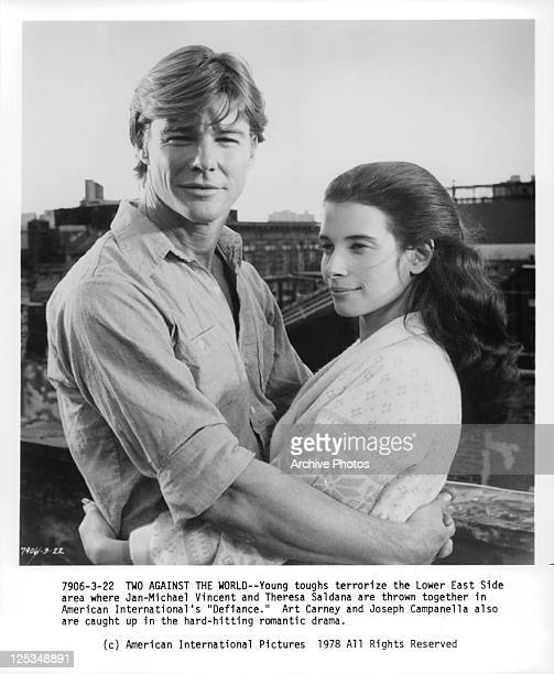 JanMichael Vincent and Theresa Saldana embracing in a scene from the film 'Defiance' 1980