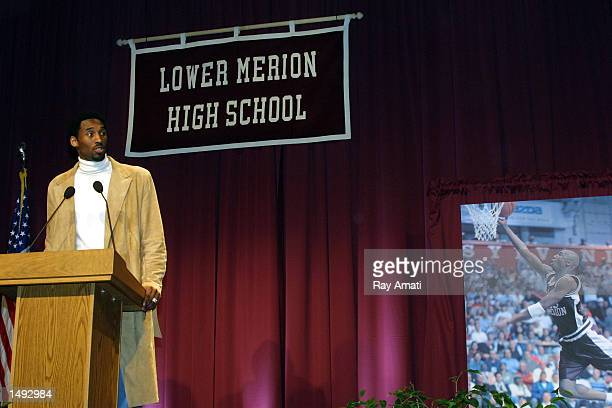 Kobe Bryant of the Los Angeles Lakers addresses a capacity crowd at his old high school where his former uniform number is retired by Lower Meridian...