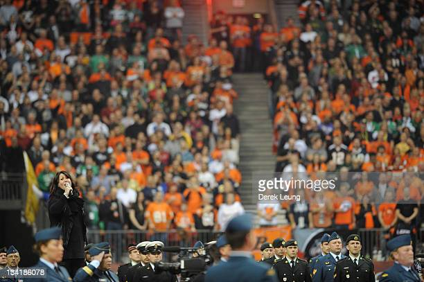 Jann Arden sings the national anthem before the game between the BC Lions and the Winnipeg Blue Bombers during the Grey Cup at BC Place on November...