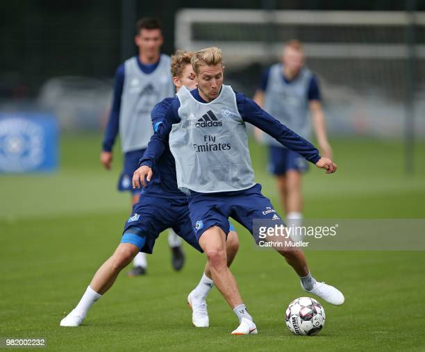 Jann Fiete Arp and Lewis Holtby in action during the first training session of the new season at Volksparkstadion on June 23 2018 in Hamburg Germany...