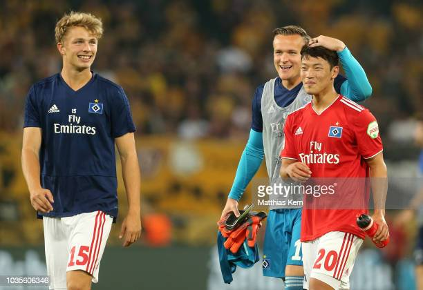 Jann Fiete Arp Tom Mickel and Hee Chan Hwang of Hamburg show their delight after winning the Second Bundesliga match between SG Dynamo Dresden and...
