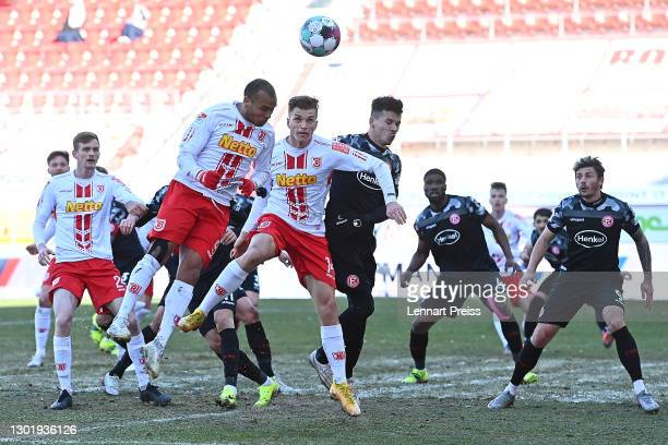 Jann George and David Otto of Regensburg battle for the ball with Alfredo Morales of Duesseldorf during the Second Bundesliga match between SSV Jahn...