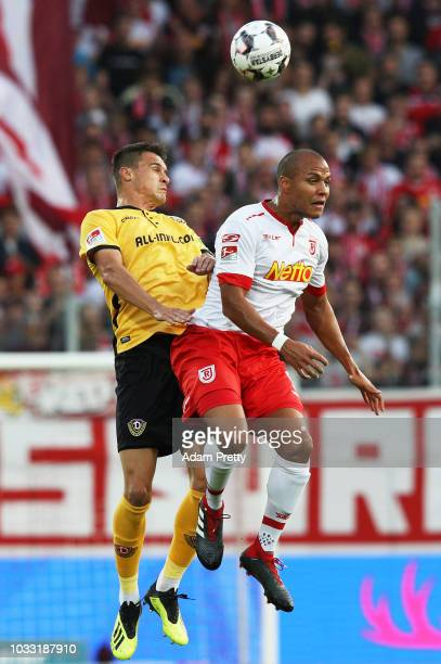 Jann George of Jahn Regensburg is challenged by Philip Heise of Dynamo Dresden during the Second Bundesliga match between SSV Jahn Regensburg and SG...