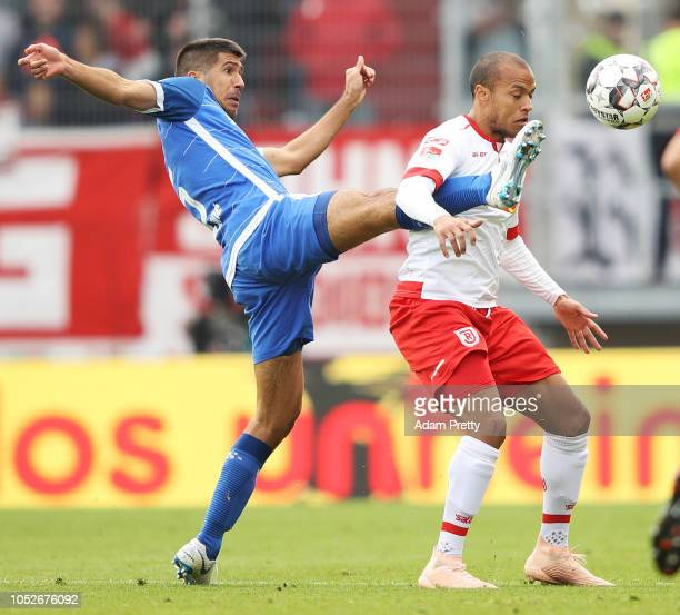 Jann George of Jahn Regensburg is challenged by Slobodan Medojevic of SV Darmstadt 98 during the Second Bundesliga match between SSV Jahn Regensburg...
