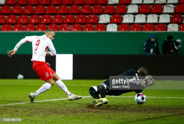 Jann George of Jahn Regensburg scores their side's second goal past Timo Horn of 1. FC Koeln during the DFB Cup Round of Sixteen match between Jahn...