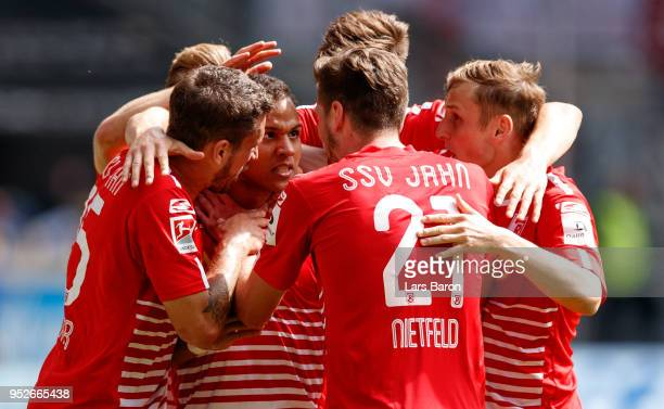 Jann George of Regensburg celebrates with team mates after scoring his teams first goal during the Second Bundesliga match between MSV Duisburg and...