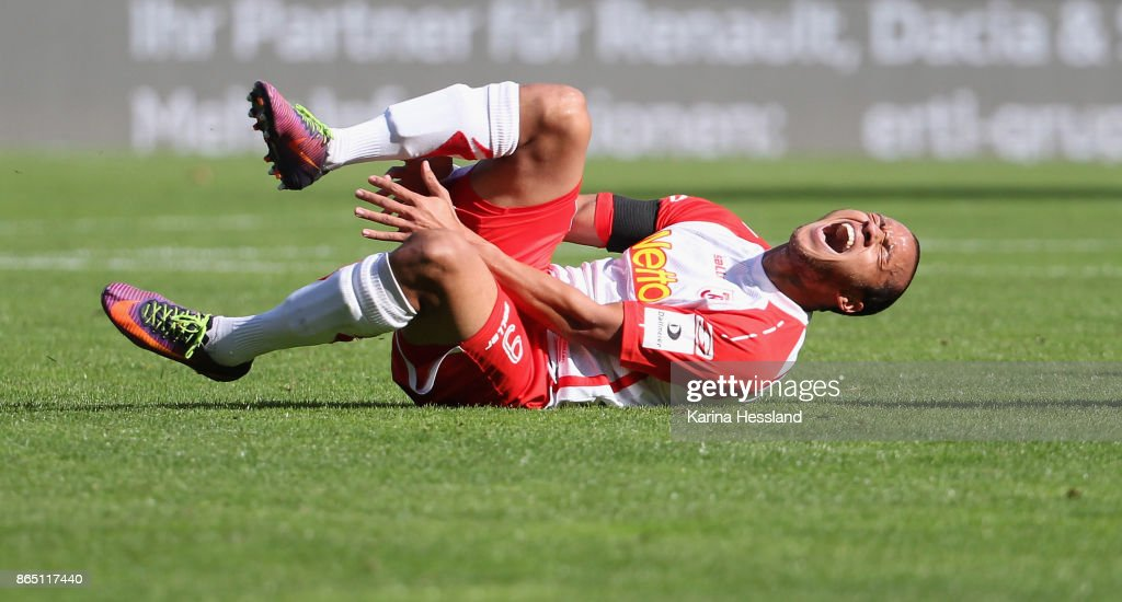 Jann George of Regensburg injured on the ground during the Second Bundesliga match between FC Erzgebirge Aue and SSV Jahn Regensburg at Sparkassen-Erzgebirgsstadion on October 22, 2017 in Aue, Germany.