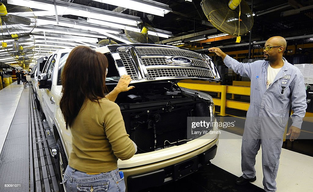 Janna Dake, a Ford inspector for 20 years, and Gregory Armstrong, a 17-year employee, work the final assembly line for the F-150 pickup at the Kansas City Ford Assembly plant October 2, 2008 in Claycomo, Missouri. Ford's Kansas City Assembly plant celebrates production of the new 2009 Ford F-150 with the official roll out.