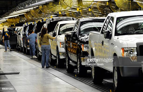 Janna Dake a Ford inspector for 20 years works the final assembly line for the F150 pickup at the Kansas City Ford Assembly plant October 2 2008 in...